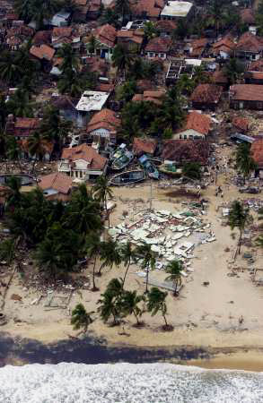 Destroyed houses and boats in Sri Lanka
