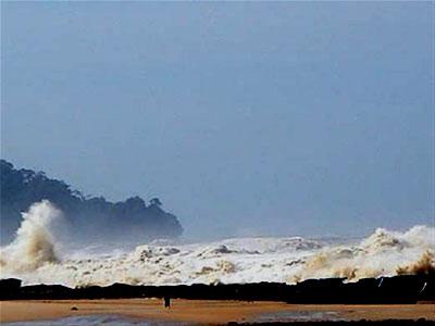 The tsunami hits the shore - Photo by John Knill and Jackie Knill