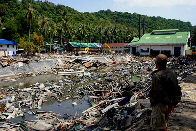 A man surveys some of the devastation in Thailand