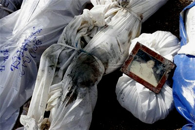 A baby's picture is placed on his dead body