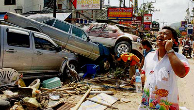 Tsunami Pictures: #7 - Three cars piled one atop the other on a street in Thailand