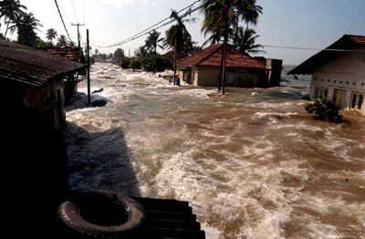 Tsunami Pictures: #3 - Houses in the Aceh province of Thailand are flooded by the tsunami